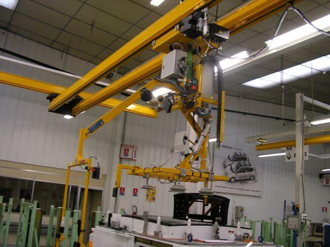 Manipulateur à 4 ventouses sous poutre roulante, pour basculement horizontal/vertical et vertical/horizontal de pièces en verre